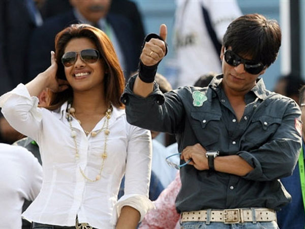 Shah Rukh Khan and Priyanka Chopra gesture as they watch the ICC Champions Trophy match between India and England at the Sawai Mansingh Stadium in Jaipur on October 15. (AFP)