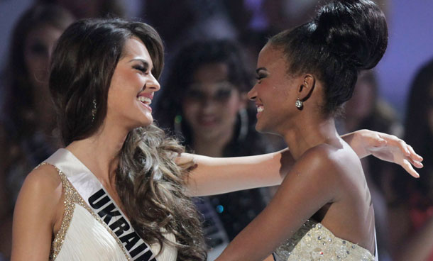 Miss Angola Leila Lopes, right, and Miss Ukraine Olesia Stefanko react after Lopes was named Miss Universe 2011 and Stefanko first runner up at the Miss Universe pageant in Sao Paulo, Brazil, Monday Sept 12, 2011. (AP)