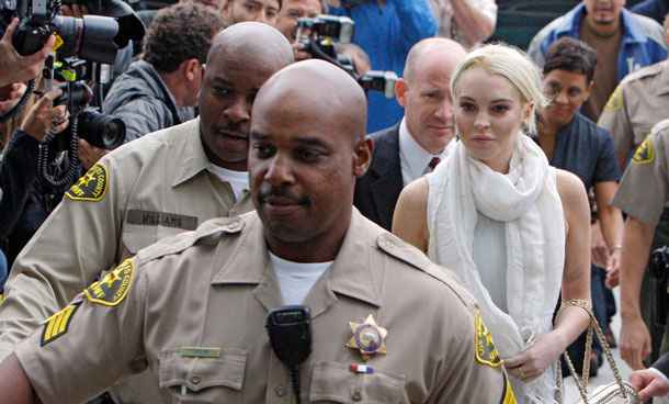 Lindsay Lohan arrives at the Los Angeles Superior Court West District Airport Courthouse Wednesday, Oct 19, 2011, in Los Angeles. A city prosecutor will recommend Wednesday that the troubled starlet be sent back to jail because she had been ousted from a community service assignment at a women's shelter. (AP)