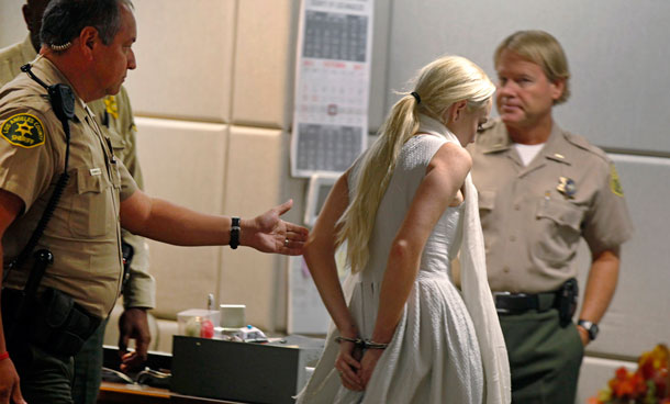 Lindsay Lohan is taken into custody by Los Angeles Country sheriffs after a judge finds her in violation of probation Wednesday, Oct 19, 2011, in Los Angeles. Superior Court Judge Stephanie Sautner revoked Lohan's probation Wednesday after the actress encountered problems during her community service assignment at a women's shelter.  Bail has been set at $100,000. (AP)