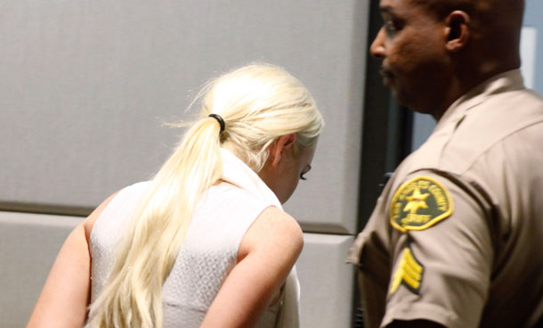 Lindsay Lohan is taken into custody by  Los Angeles Country sheriff deputies after a judge found her in violation of probation Wednesday, Oct 19, 2011, in Los Angeles. (AP)