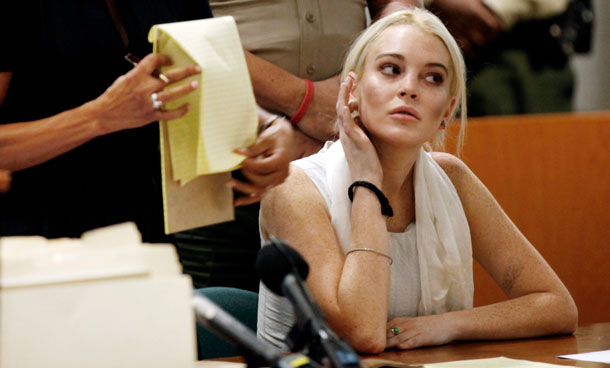 Lindsay Lohan, right, alongside her attorney Shawn Chapman Holley, is shown before being taken into custody by Los Angeles Country sheriffs deputies after a judge found her in violation of probation Wednesday, Oct 19, 2011, in Los Angeles.(AP)