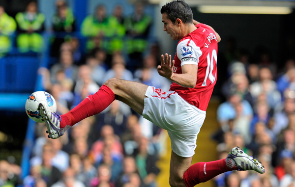Arsenal s robin van persie guides the ball towards the goal but fails