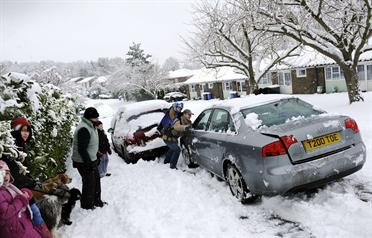 <p>People attempt to push a stranded car out of the snow on a road in Hartley Wintney, Hampshire, a village 40 miles west of London. Britain's longest spell of bad winter weather in decades caused chaos for travellers Wednesday as snow and ice hit airports and roads, while bitterly cold temperatures cloaked much of Europe. Millions of people in London and the south-east of England woke up to heavy snow after storms spread overnight from Scotland and the north of England, where they have caused p