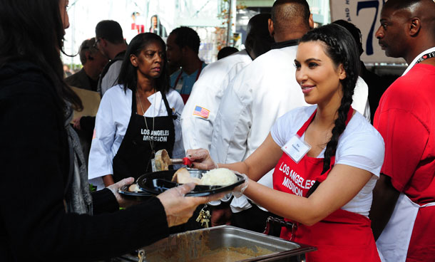 Socialite Kim Kardashian pose for photos as celebrities turn out to feed the homeless and those less fortunate a lunchtime meal at the Los Angeles Mission on Nov 23, 2011 in downtown LA in celebration of Thanksgiving. The LA Mission has been helping people on skid row for the past 75 years, providing emergency services like shelter, food, clothing as well as professional medical and dental services. (AFP)