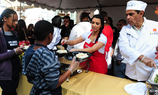 Kim Kardashian (C) and Los Angeles Mayor Antonia Villaraigosa (R) feed the homeless and those less fortunate at the Los Angeles Mission on November 23, 2011 in downtown LA in celebration of Thanksgiving. The LA Mission has been helping people on skid row for the past 75 years, providing emergency services like shelter, food, clothing as well as professional medical and dental services. (AFP)
