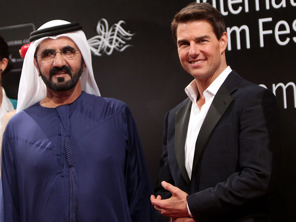 His Highness Sheikh Mohammed bin Rashid Al Maktoum, Vice-President and Prime Minister of the UAE and Ruler of Dubai with US actor Tom Cruise (R) poses on the red carpet upon their arrival to the opening ceremony of the Dubai International Film Festival (DIFF) in the Gulf emirate on December 7, 2011. (AFP)