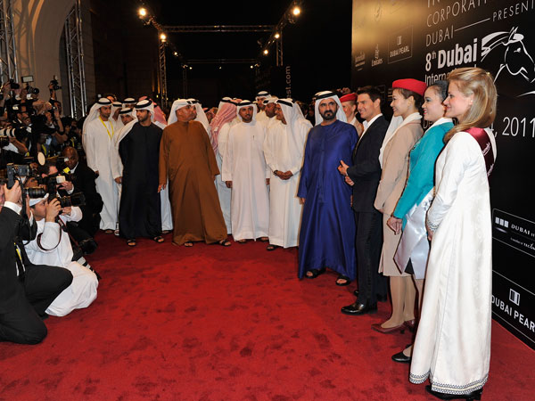 "His Highness Sheikh Mohammed bin Rashid Al Maktoum, Vice-President and Prime Minister of the UAE and Ruler of Dubai (fifth right) and actor Tom Cruise (fouth right) and guests attend the ""Mission: Impossible - Ghost Protocol"" Premiere during day one of the 8th Annual Dubai International Film Festival held at the Madinat Jumeriah Complex on December 7, 2011 in Dubai, United Arab Emirates. (GETTY)"