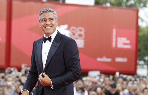 George Clooney poses on the red carpet for the premiere of his movie 'The Ides of March', which opens the 68th edition of the Venice Film Festival in Venice, Italy. (AP)
