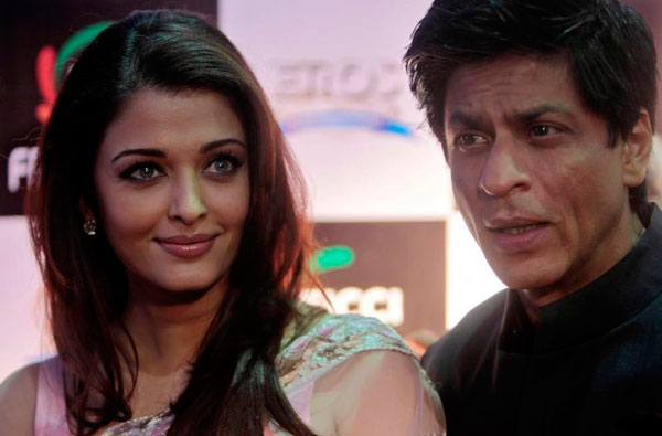 Bollywood actors Shah Rukh Khan, right, and Aishwarya Rai Bachchan pose for the media during FICCI frames 2011 in Mumbai, India, Friday, March 25, 2011. (AP)