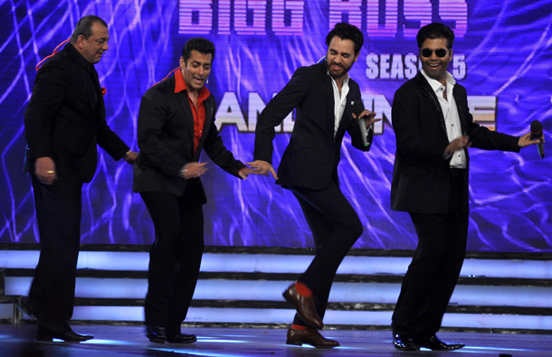 Indian Bollywood actors Sanjay Dutt (L) and Salman Khan (2L) perform with fellow actor Imran Khan (2R) and director Karan Johar (R)on the set of Indian television Reality Show at Colors 'Bigg Boss Season 5' in Mumbai. (AFP)