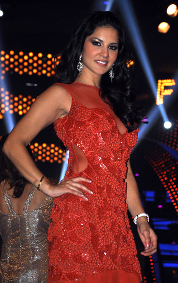 The Indo-Canadian porn star Sunny Leone poses on the set of Indian TV Reality Show 'Bigg Boss Season 5' in Mumbay. (AFP)