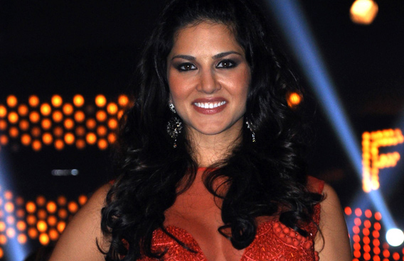 The Indo-Canadian porn star Sunny Leone poses on the set of Indian TV Reality Show 'Bigg Boss' in Mumbay. (AFP)