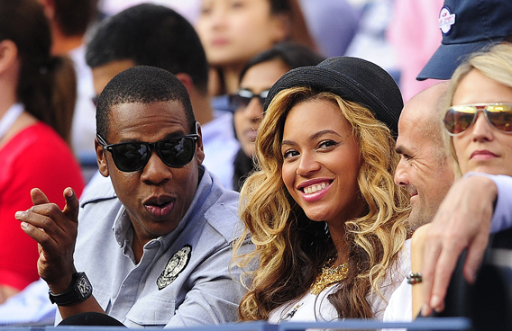 US singers Jay-Z and Beyonce watching Spanish tennis player Rafael Nadal play Serbia's Novak Djokovic in the men's US Open 2011 final at the USTA Billie Jean King National Tennis Center in New York. (AFP)