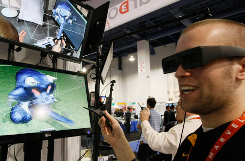 "A showgoer uses the Leonardo 3D interactive device to design a sculpture at the Consumer Electronics Show in Las Vegas January 11, 2012. Wearing 3D glasses and using a 3D ""mouse"" called a bird the user can create objects in virtual reality. Available now, the cost ranges from $1,000 to $1,300 (REUTERS)"