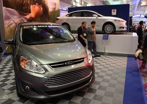 The 2013 Ford C-Max Energi (L) and 2013 Ford Fusion Energi hybrids are displayed in the lobby of the Las Vegas Convention Center during the 2012 International Consumer Electronics Show (CES) in Las Vegas, Nevada January 11, 2012. The Fusion Energi is expected to hit over 100 miles per gallon (42.5 km per liter) equivalent (MPGe), according to the company. CES, the world's largest consumer technology tradeshow, runs through January 13 (REUTERS)