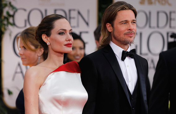 Actress and director Angelina Jolie (L) and actor Brad Pitt arrive at the 69th annual Golden Globe Awards in Beverly Hills, California. (REUTERS)