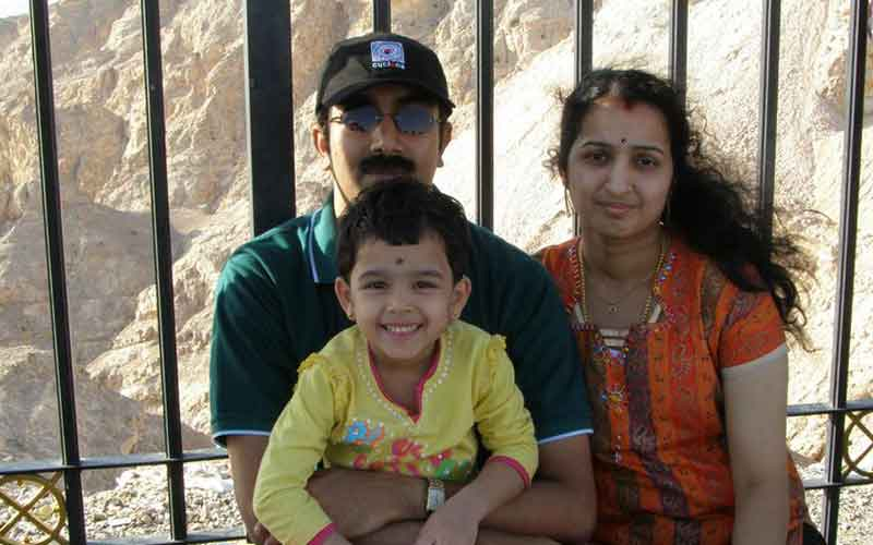 Rijesh, Shreesha and kid during happier times (SUPPLIED)