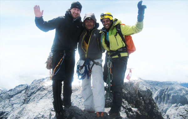Atte, Delanii & climbing leader Poxy at the summit of Carstensz Pyramid (SUPPLIED)
