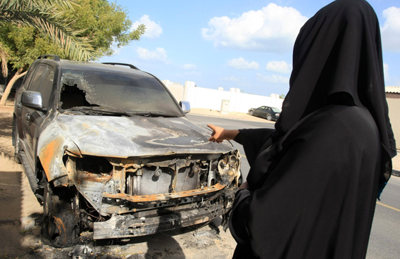 A resident to a car which was intentionally burnt by young thugs who threw bottle filled with petrol at a residential area in Al Qouz in Dubai. (Patrick Castillo)