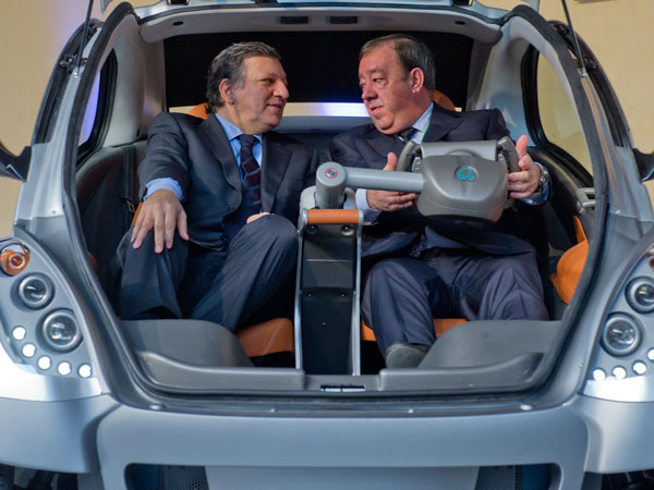 EU Commission President Jose Manuel Barroso and Jesus Echave, chairman of the HIRIKO-AFYPAIDA corporate consortiumk, sit in the first prototype of the HIRIKO electric car, during the global launch of Hiriko Driving Mobility at the EU Commssion headquarters on January 24, 2012 in Brussels, Belgium. (GETTY)