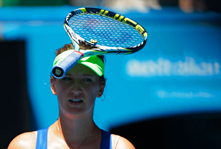 Victoria Azarenka of Belarus rests her racquet on her head during her women's singles semi-final match against Kim Clijsters of Belgium at the Australian Open tournament in Melbourne on Thursday. (REUTERS)