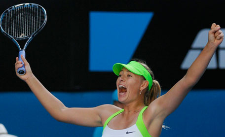 Russia's Maria Sharapova celebrates after defeating Petra Kvitova of the Czech Republic in their women's singles semifinal at the Australian Open in Melbourne on Thursday. (REUTERS)
