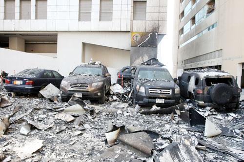 Damaged cars parked near the Al Bakar 'A' Tower (Chandra Balan)