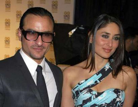 Bollywood actors Saif Ali Khan (L) and Kareena Kapoor pose for a photgraph. (REUTERS)