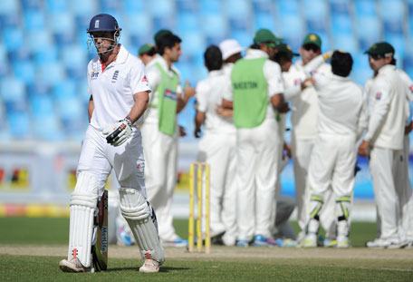 England captain Andrew Strauss leaves the field after being dismissed by Abdur Rehman of Pakistan during the third Test at the Dubai International Cricket Stadium on Monday. (GETTY)