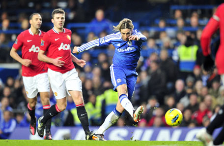 Chelsea's striker Fernando Torres takes a shot during their English Premier league match against Manchester United at Stamford Bridge in London, on Sunday. (AFP)