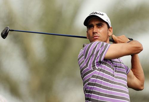 Rafael Cabrera-Bello of Spain hits his tee-shot on the eighth hole during the first round of the Omega Dubai Desert Classic at the Emirates Golf Club on February 9, 2012 in Dubai (Getty Images)