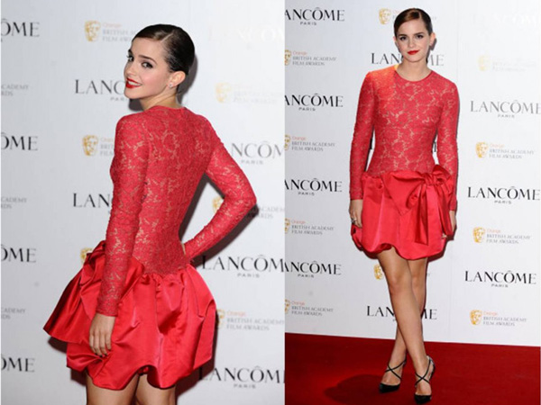 Emma Watson in red lace and satin dress by Valentino. (GETTY)