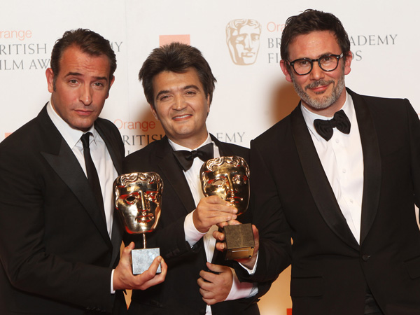 L-R Jean Dujardin, Thomas Langmann and Michel Hazanavicius pose with their awards for The Artist in the press room at The Orange British Academy Film Awards 2012 at The Royal Opera House on February 12, 2012 in London, England. (GETTY)