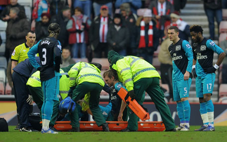 Per Mertesacker of Arsenal is put on a stretcher as he is substituted after suffering an injury during the Barclays Premier League match against Sunderland at the Stadium of Light on Saturday in England. (GETTY)