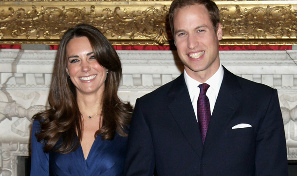 Prince William and Kate Middleton pose for photographs in the State Apartments of St James Palace in London, England. After much speculation, Clarence House today announced the engagement of Prince William to Kate Middleton. The couple will get married in either the Spring or Summer of next year and continue to live in North Wales while Prince William works as an air sea rescue pilot for the RAF. The couple became engaged during a recent holiday in Kenya having been together for eight years. (GETTY IMAGES)