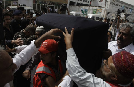 People carry a body of a Pakistani acid attack victim Fakhra Younnus, at Karachi airport in Pakistan. (AP)