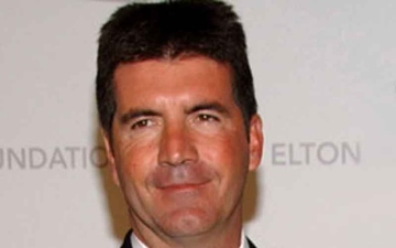 Photo: Simon Cowell gives 'some good advice' after electric bike accident