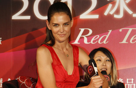 """Actress Katie Holmes listens to questions during a press conference to promote an ice skating event """"Artistry on Ice"""" in Taipei, Taiwan. (AP)"""