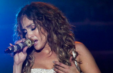 """Singer Jennifer Lopez performs during a concert as part of her """"Dance Again World Tour"""" in Caracas June 16, 2012. (REUTERS)"""