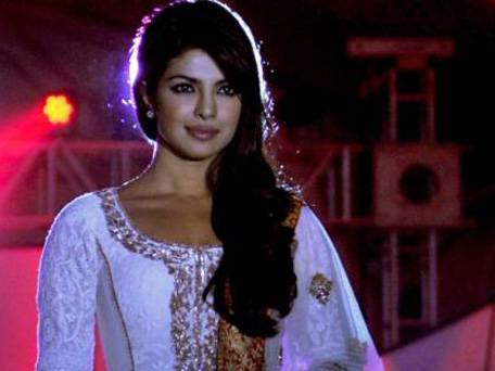 Indian Bollywood film actress Priyanka Chopra walks the ramp during the seventh annual Pidilite-CPAA Charity Fashion Show showcasing designers Manish Malhotra and Shaina NC in support of the Cancer Patients Aid Association (CPAA) in Mumbai on July 1, 2012. (AFP)