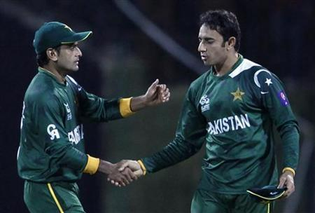 Pakistan's Saeed Ajmal (R) is congratulated by his team captain Mohammad Hafeez after he took the wicket of New Zealand's Tim Southee (not seen) during their Twenty20 World Cup cricket match in Pallekele September 23, 2012. (REUTERS)