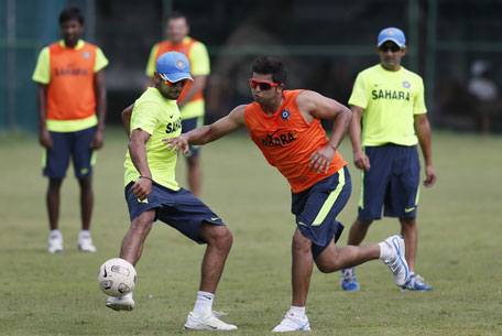 India's Virat Kohli, left foreground, and Suresh Raina, right foreground, fight for a soccer ball during a warm-up session ahead of their ICC Twenty20 Cricket World Cup Super Eight match against Pakistan, in Colombo, Sri Lanka, Saturday, Sept. 29, 2012. (AP)