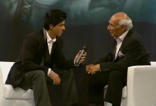 Actor Shah Rukh Khan in conversation with director and mentor Yash Chopra. (Still from video)