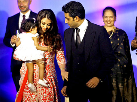 Aishwarya Rai Bachchan got a grand birthday gift this year! The actress holds her daughter Aaradhya as her husband actor Abhishek Bachan walks with her after she was conferred with the French civilian award, Officer Dan Ordre Arts et des Lettres in Mumbai on November 1. (AP)
