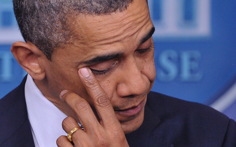 US President Barack Obama wipes his eye as he speaks during a previously unannounced appearance in the Brady Briefing Room of the White House on December 14, 2012 in Washington, DC. Obama spoke following the shooting in a Connecticut Elementary School which left at least 27 people dead. (AFP)