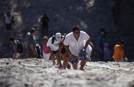 Tourists climb the Maya pyramid of Nohoch Mul at the archaeological site of Coba. (REUTERS)
