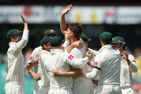 Jackson Bird of Australia celebrates with team mates after dismissing Dimuth Karunaratne of Sri Lanka during day one of the third Test at the Sydney Cricket Ground on January 3, 2013 in Sydney, Australia. (GETTY)