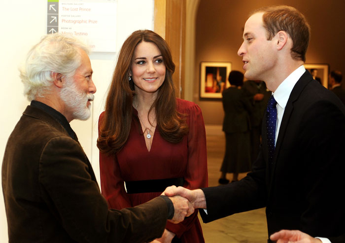 Prince William, who also said he loved Kate's portrait, shook hands with the artist. (AP)