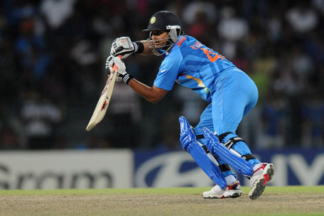 Suresh Raina leads India's fight back. (GETTY)